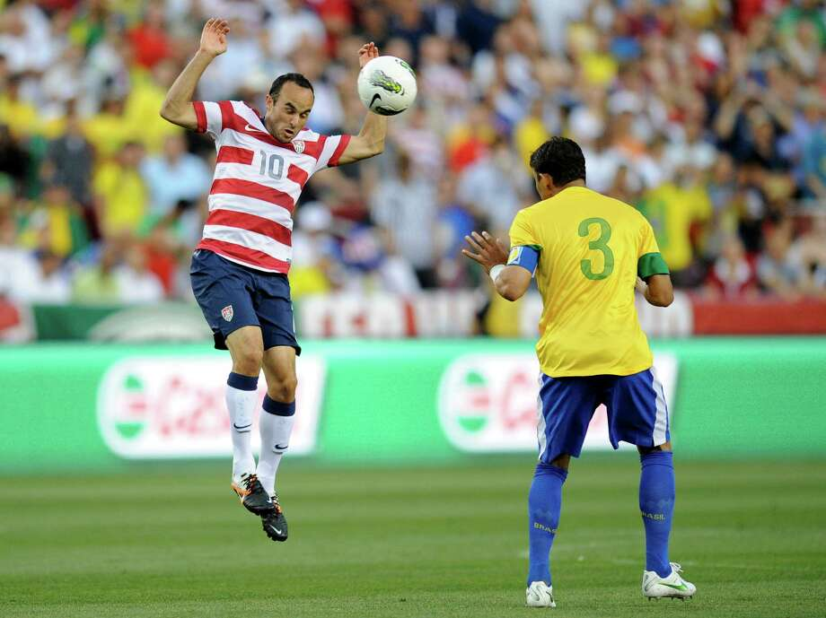 United States' forward Landon Donovan (10) battles for the ball against Brazil's Thiago Silva (3) during the first half of an international friendly soccer game on Wednesday, May 30, 2012, in Landover, Md. (AP Photo/Nick Wass) Photo: Nick Wass, Associated Press / FR67404 AP