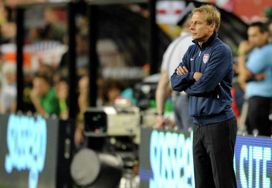 United States head coach Jurgen Klinsmann looks on from the sidelines during the first half of an international friendly soccer game against Brazil, Wednesday, May 30, 2012, in Landover, Md. (AP Photo/Nick Wass) Photo: Nick Wass, Associated Press / FR67404 AP