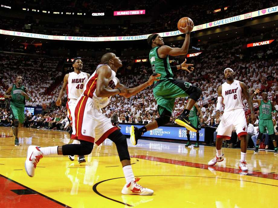 MIAMI, FL - MAY 30:  Rajon Rondo #9 of the Boston Celtics drives for a shot attempt n the first half against James Jones #22 and LeBron James #6 of the Miami Heat in Game Two of the Eastern Conference Finals in the 2012 NBA Playoffs on May 30, 2012 at American Airlines Arena in Miami, Florida. NOTE TO USER: User expressly acknowledges and agrees that, by downloading and or using this photograph, User is consenting to the terms and conditions of the Getty Images License Agreement.  (Photo by Mike Ehrmann/Getty Images) Photo: Mike Ehrmann