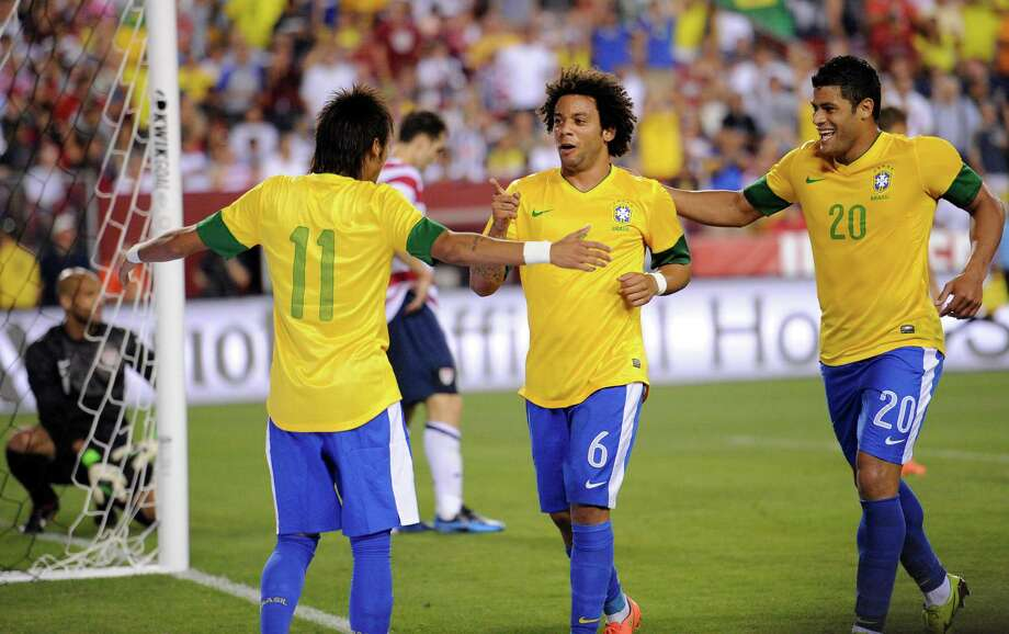 Brazil's Marcelo (6) celebrates his goal with Neymar (11) and Hulk (20) during the second half of an international friendly soccer game against the United States, Wednesday, May 30, 2012, in Landover, Md. Brazil won 4-1. (AP Photo/Nick Wass) Photo: Nick Wass, Associated Press / FR67404 AP