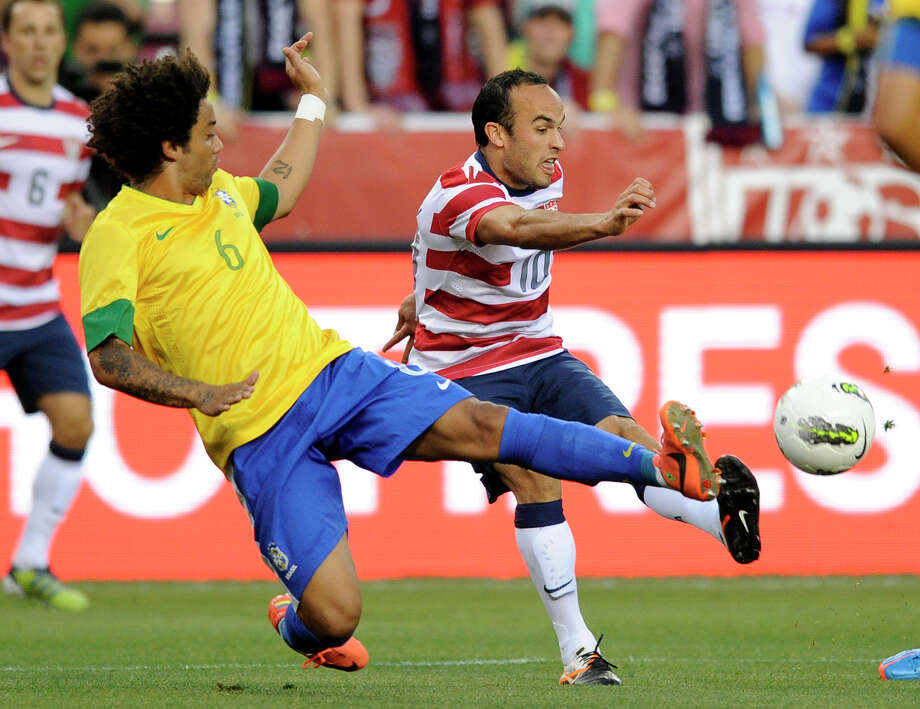 United States' Landon Donovan (10) kicks the ball against Brazil's Marcelo (6) during the first half of an international friendly soccer game on Wednesday, May 30, 2012, in Landover, Md. (AP Photo/Nick Wass) Photo: Nick Wass, Associated Press / FR67404 AP