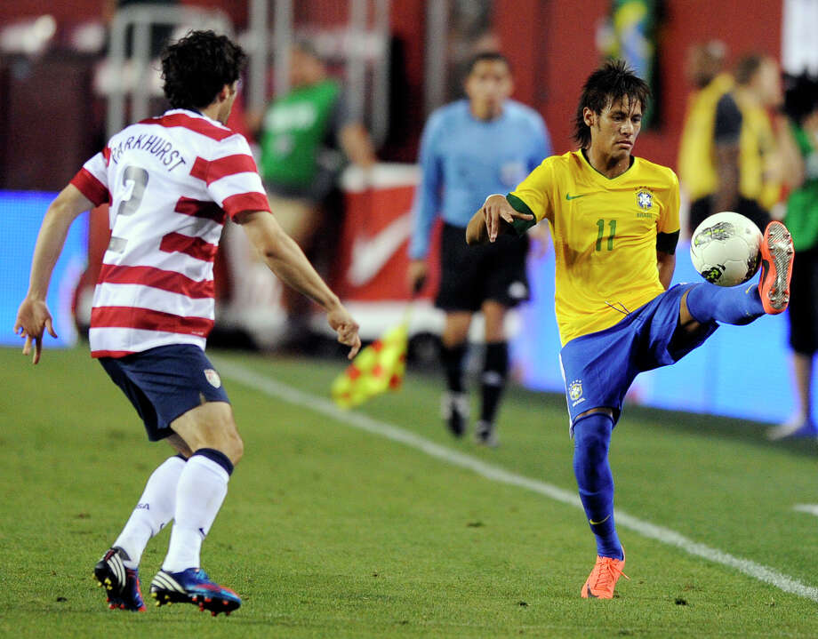 Brazil's Neymar (11) controls the ball against United States' Michael Parkhurst (2) during the second half of an international friendly soccer game, Wednesday, May 30, 2012, in Landover, Md. Brazil won 4-1. (AP Photo/Nick Wass) Photo: Nick Wass, Associated Press / FR67404 AP