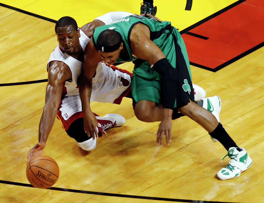 A loose ball keeps the Heat's Dwyane Wade, left, and the Celtics' Paul Pierce preoccupied during first-half action. Wade scored 23 points to Pierce's 21 as Miami took a 2-0 lead in the Eastern Conference finals Wednesday night. Photo: Wilfredo Lee / AP
