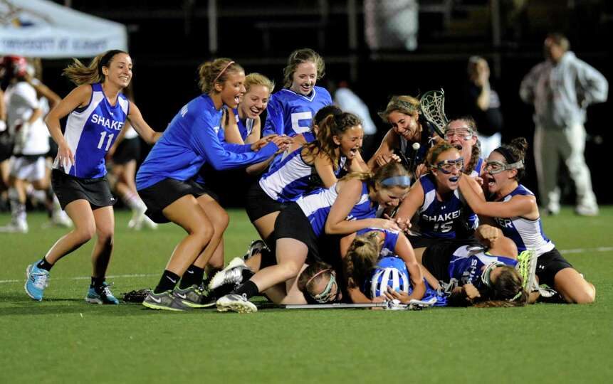 Shaker celebrates a 9-8 win over  Guilderland during their Section II Class A girls' lacrosse champi