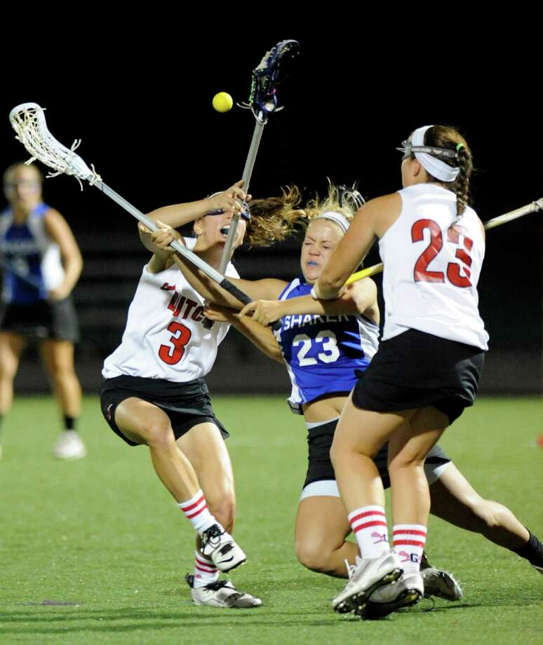 Guilderland's Christine Bolognino (3) and teammate Kara Carmen (23) right, battle with Shaker's Maddie Devine (23) during their Section II Class A girls' lacrosse championship at the University at Albany in Albany, N.Y., Wednesday, May 30, 2012. (Hans Pennink / Special to the Times Union) High School Sports Photo: Hans Pennink / Hans Pennink