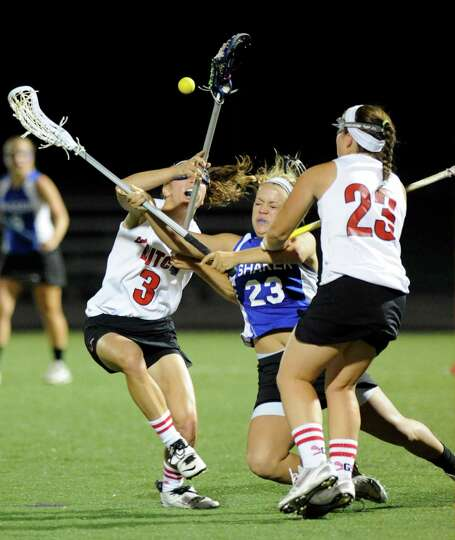 Guilderland's Christine Bolognino (3) and teammate Kara Carmen (23) right, battle with Shaker's Madd