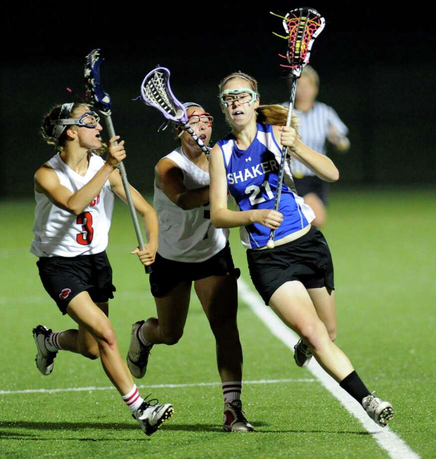 Shaker's Eva Torncello (21) is defended by Guilderland's Christine Bolognino (3) and Jenna Walsh (7) during their Section II Class A girls' lacrosse championship at the University at Albany in Albany, N.Y., Wednesday, May 30, 2012. (Hans Pennink / Special to the Times Union) High School Sports Photo: Hans Pennink / Hans Pennink