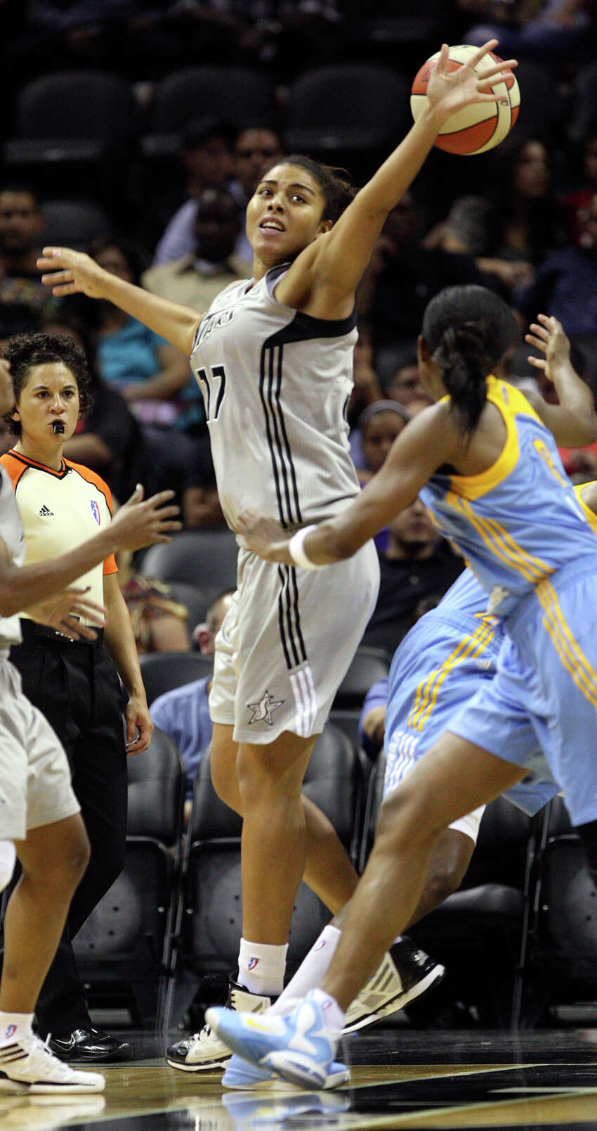 San Antonio Silver Stars' Ziomara Morrison reaches for a rebound against the Chicago Sky during the first half at the AT&T Center, Wednesday, May 30, 2012. It is the season opener for the Stars