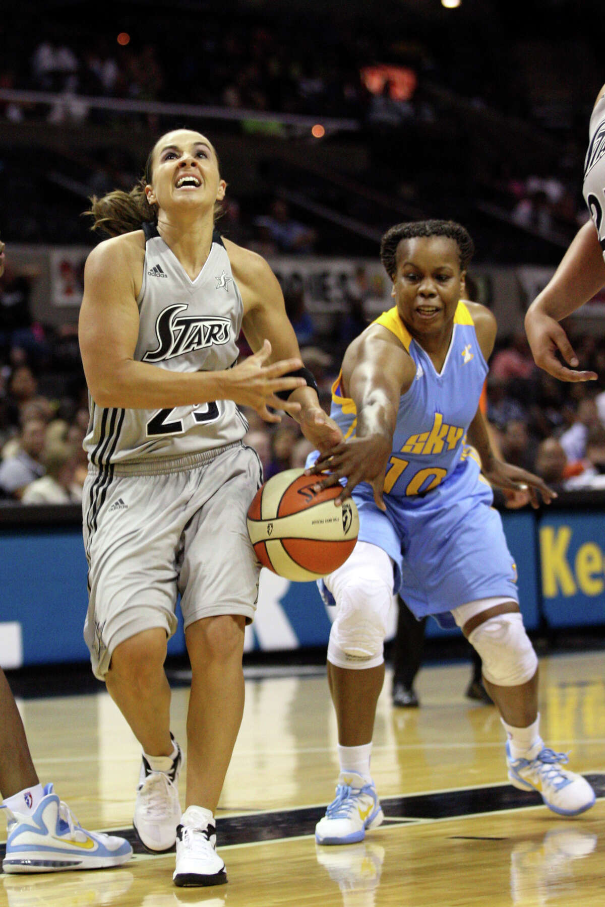San Antonio Silver Stars' Becky Hammon gets the ball striped by Chicago Sky's Epiphanny Prince during the first half at the AT&T Center, Wednesday, May 30, 2012.