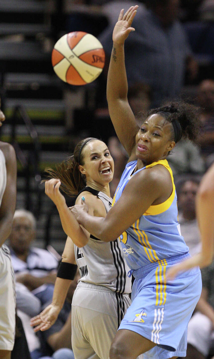 San Antonio Silver Stars' Becky Hammon tries to reach for the ball as Chicago Sky's Le'coe Willingham block her during the second half at the AT&T Center, Wednesday, May 30, 2012. The Silver Stars lost their season opener, 77-63.