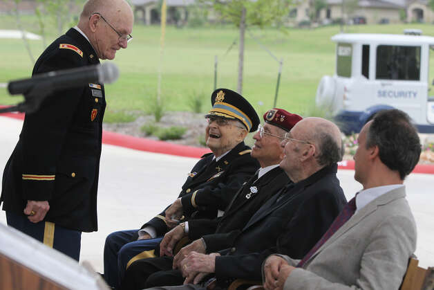 Master of Ceremonies Donald Bartlett (standing, left) speaks with French Legion of Honor awardees Edward Kerker (left, seated, smiling), George Silvas (wearing beret) and Harry Nixon Wednesday May 30, 2012 at a ceremony at the Army Residence Community at 7400 Crestway. Kerker, Silvas and Nixon were honored at the ceremony with the French Legion of Honor Award by French Consul General Frederic Bontems (right) for serving courageously during World War II to free France from Nazi tyranny. Wednesday, May 30, 2012. Photo: San Antonio Express-News