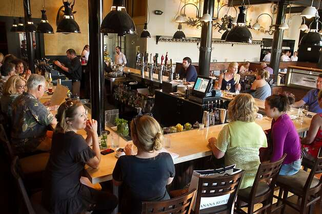 People enjoy dinner at the bar at Corners Tavern in Walnut Creek, Calif., on Saturday, May 19th, 2012. Photo: John Storey