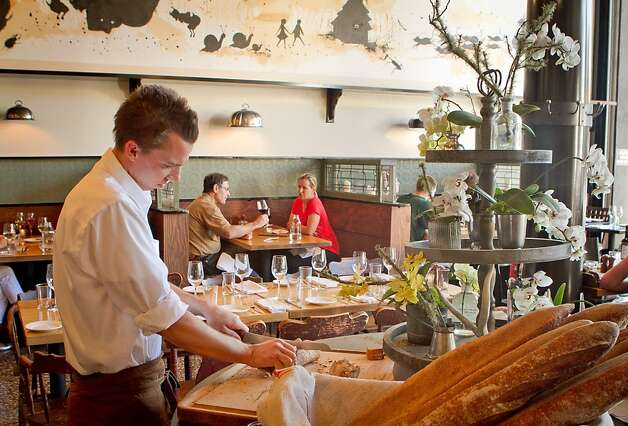 A server cuts bread at Corners Tavern in Walnut Creek, Calif., on Saturday, May 19th, 2012. Photo: John Storey