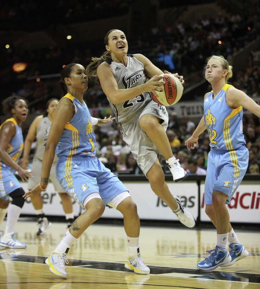 Becky Hammon of the Silver Stars dodges two Chicago Sky players as she attempts to shoot during the second half of the game Wednesday May 30, 2012 at the AT&T Center. The Stars ended with a 77-63 victory against the Sky. Photo: Julysa Sosa, Express-News / © 2012 San Antonio Express-News