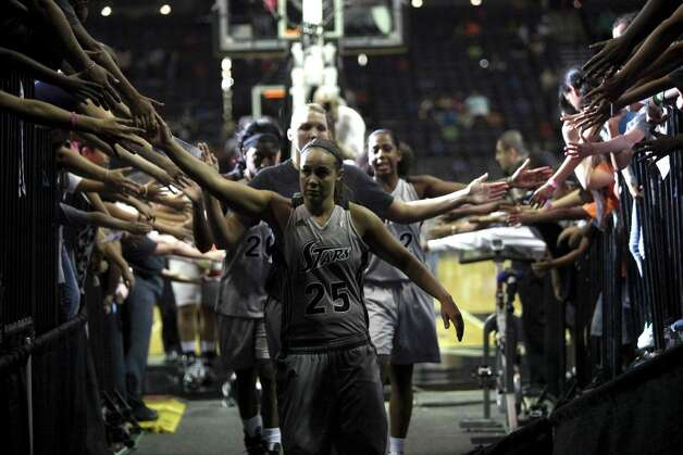 Becky Hammon and the rest of the team greet fans as they walk off the court after a 73-66 win against the Chicago Sky Wednesday May 30, 2012 at the AT&T Center. Photo: Julysa Sosa, Express-News / © 2012 San Antonio Express-News