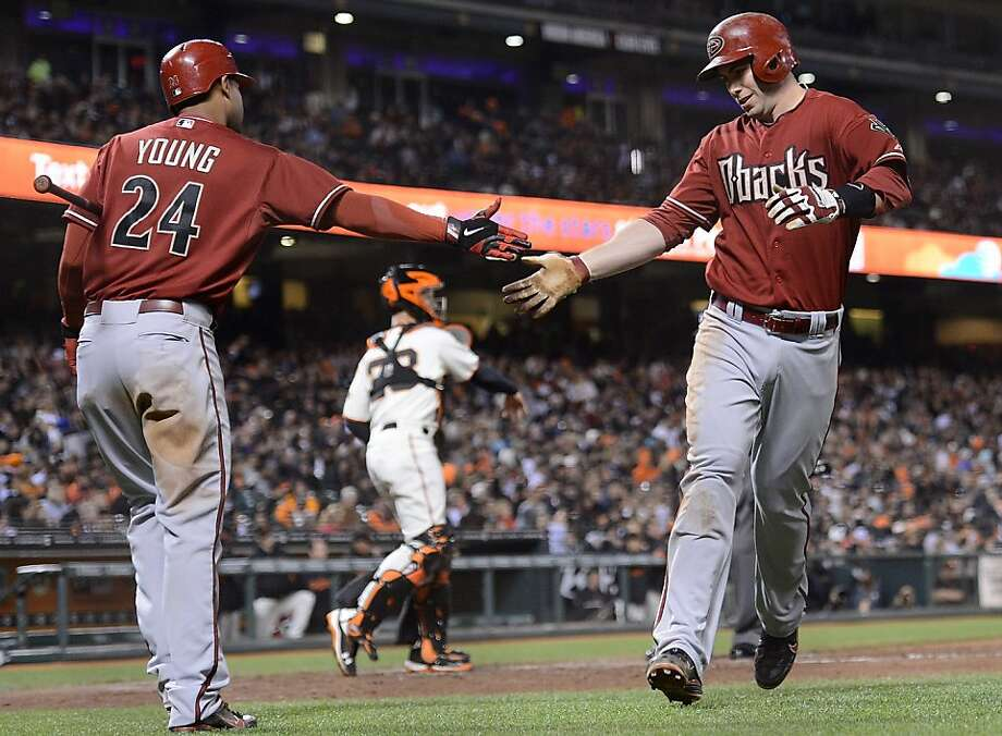 SAN FRANCISCO, CA - MAY 30:  Paul Goldschmidt #44 of the Arizona Diamondbacks gets congratulated by Chris Young #24 after hitting a solo home run in the six inning against the San Francisco Giants at AT&T Park on May 30, 2012 in San Francisco, California.  (Photo by Thearon W. Henderson/Getty Images) Photo: Thearon W. Henderson, Getty Images