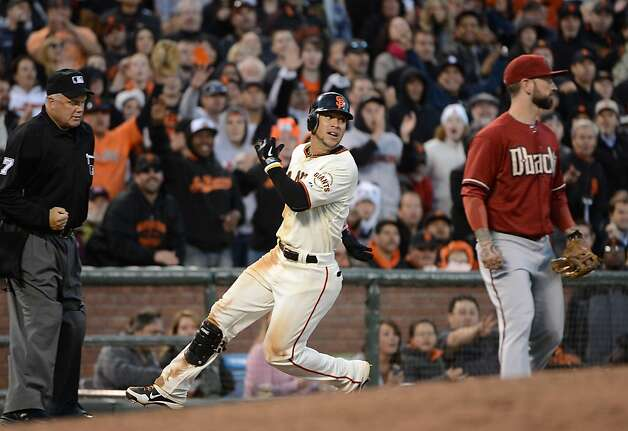 SAN FRANCISCO, CA - MAY 30:  Gregor Blanco #7 of the San Francisco Giants looks back while going into third base with a triple as Ryan Roberts #14 of the Arizona Diamondbacks looks on in the fourth inning at AT&T Park on May 30, 2012 in San Francisco, California.  (Photo by Thearon W. Henderson/Getty Images) Photo: Thearon W. Henderson, Getty Images