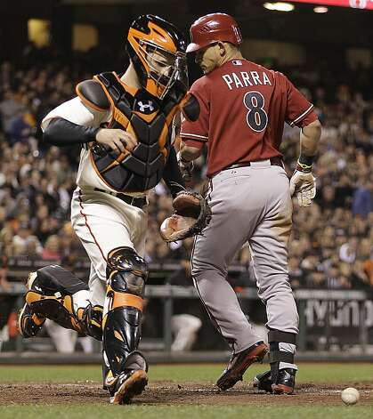 San Francisco Giants catcher Buster Posey, left, chases a pitch from Tim Lincecum that got away from him behind Arizona Diamondbacks Gerardo Parra (8) in the seventh inning of a baseball game Wednesday, May 30, 2012, in San Francisco. (AP Photo/Ben Margot) Photo: Ben Margot, Associated Press