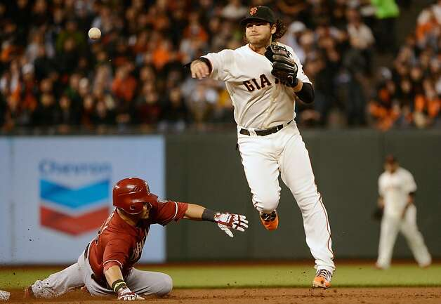 SAN FRANCISCO, CA - MAY 30:  Brandon Crawford #35 of the San Francisco Giants gets his throw off to complete the double-play while avoiding the slide of Gerardo Parra #8 of the Arizona Diamondbacks in the fifth inning at AT&T Park on May 30, 2012 in San Francisco, California.  (Photo by Thearon W. Henderson/Getty Images) Photo: Thearon W. Henderson, Getty Images