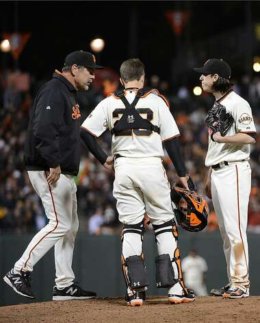 SAN FRANCISCO, CA - MAY 30: Manager Bruce Bochy #15 comes out to talk with pitcher Tim Lincecum #55 and catcher Buster Posey #28 in the seventh inning against the Arizona Diamondbacks at AT&T Park on May 30, 2012 in San Francisco, California.  (Photo by Thearon W. Henderson/Getty Images) Photo: Thearon W. Henderson, Getty Images