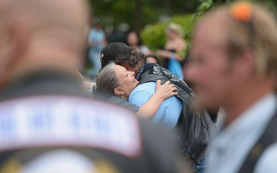 NEW YORK, NY - MAY 30:  9/11 first responder Frank Silecchia gets a hug from a friend before the march towards The Freedom Tower to be honored with fellow first responders by Mayor Michael R. Bloomberg on May 30, 2012 in New York City. The ceremony commemorates the 10th anniversary of the official end of clean up from the 9/11 attacks.  (Photo by Michael Loccisano/Getty Images) Photo: Michael Loccisano, Getty Images