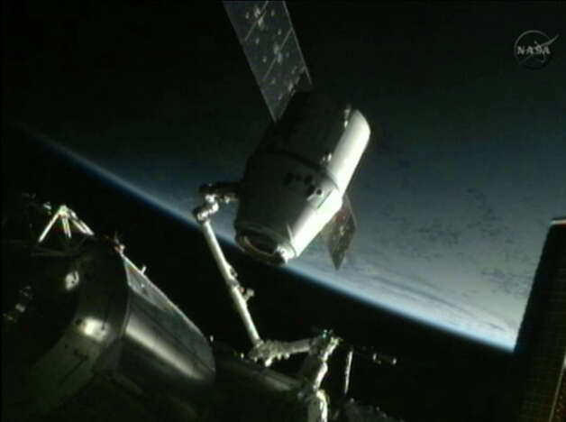 This framegrab image from NASA-TV shows the SpaceX Dragon capsule just after ...