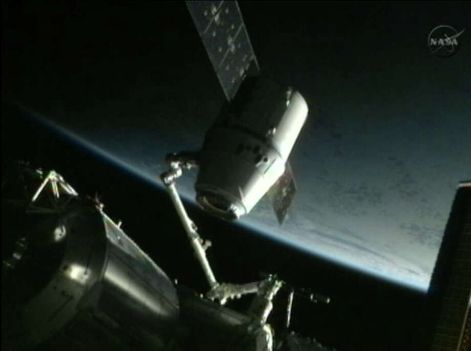 This framegrab image from NASA-TV shows the SpaceX Dragon capsule just after the capsule is backed away from the International Space Station and being repositioned for release later Thursday morning May 31, 2012. The Dragon capsule is scheduled for splashdown at 11:44 a.m. EDT Thursday in the Pacific Ocean. (AP Photo/NASA) Photo: Uncredited