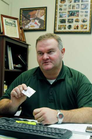 In this Jan. 18, 2011 photo, Itawamba County Sheriff Chris Dickinson holds a packet of what is being sold as bath salts at his office in Fulton, Miss. The product, which can be legally purchased, contain stimulants which authorities claim can cause hallucinations, paranoia and suicidal thoughts and are now among the newest substances law enforcement agents are having to deal with in the streets. Photo: Rogelio V. Solis, AP / AP