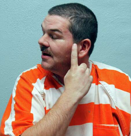 In this Jan. 18, 2011 photo, Itawamba County inmate Neil Brown describes at the jail in Fulton, Miss., self-induced injuries he incurred while having hallucinations after ingesting a bath salt powder that is being sold at convenience stores and over the Internet. The product, which can be legally purchased, contains stimulants which authorities claim can cause hallucinations, paranoia and suicidal thoughts and are now among the newest substances law enforcement agents are having to deal with in the streets. Photo: Rogelio V. Solis, AP / AP