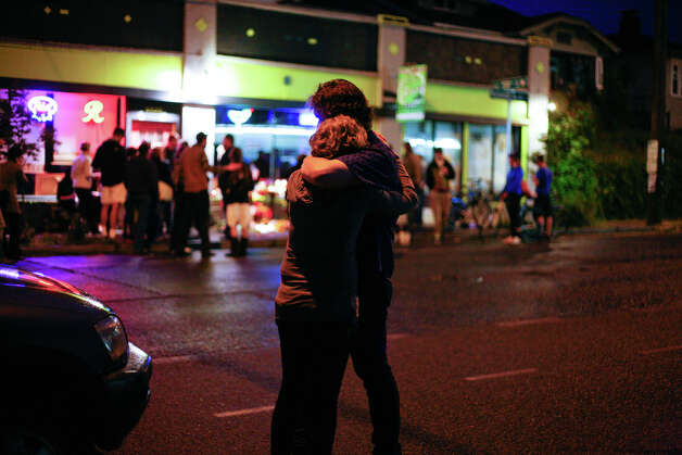 People grieve for the victims after five people were shot at Cafe Racer on Roosevelt Way NE in Seattle. Photo: SOFIA JARAMILLO / SEATTLEPI.COM