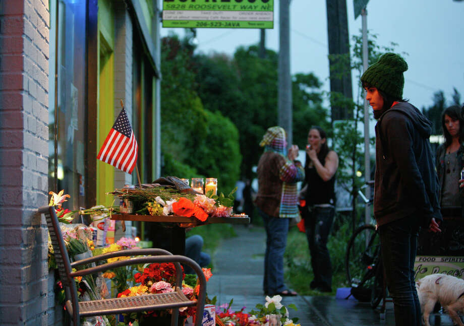 Flowers and candles are set in front of the Cafe Racer on May 30, 2012, after five people were shot at the cafe on Roosevelt Way Northeast in Seattle. Photo: SOFIA JARAMILLO / SEATTLEPI.COM