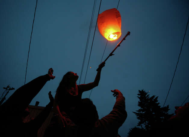 Floating lanterns set afloat during a vigil after five people were shot at Cafe Racer on Roosevelt Way NE in Seattle. Four of the victims died from the violence. A fifth person was shot and killed in downtown Seattle about 30 minutes later. Seattle Police said they believed it was by the same suspect. The suspect later shot himself in West Seattle. Photo: SOFIA JARAMILLO / SEATTLEPI.COM