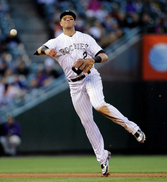 Colorado Rockies shortstop Troy Tulowitzki thows out Houston Astros' Jordan Schafer at first base in