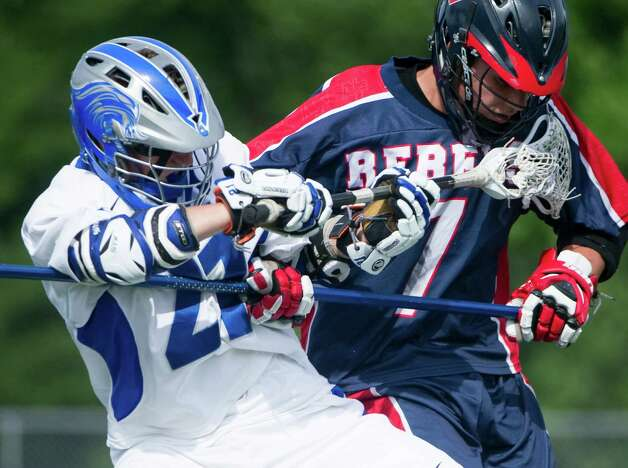Darien's Tim Murphy and New Fairfield's Luke McFadden battle as Darien High School hosts New Fairfield in Class M boys lacrosse in Darien, Conn., May 30, 2012. Photo: Keelin Daly / Stamford Advocate