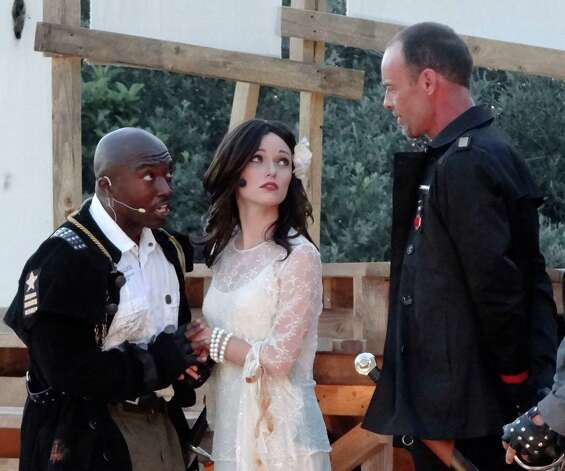 "Othello, left, played by James ""Apollo"" Bradley, and Desdemona, played by Kat Connor, speak with Iago, played by Dylan Collins, during the Magik Theatre production of ""Othello,"" part of the Shakespeare in the Park series, at the San Antonio Botanical Gardens, on Wednesday, May 30, 2012. Photo: Billy Calzada, San Antonio Express-News / © 2012 San Antonio Express-News"