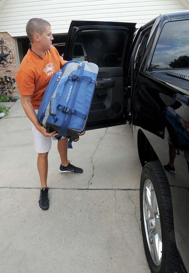 Lamar's Jude Vidrine packs his truck Wednesday before driving to Victoria for the Texas Collegiate League baseball camp. Vidrine and others will play about 60 games during the 10 week program. Photo taken Wednesday, May 30, 2012 Guiseppe Barranco/The Enterprise Photo: Guiseppe Barranco, STAFF PHOTOGRAPHER / The Beaumont Enterprise