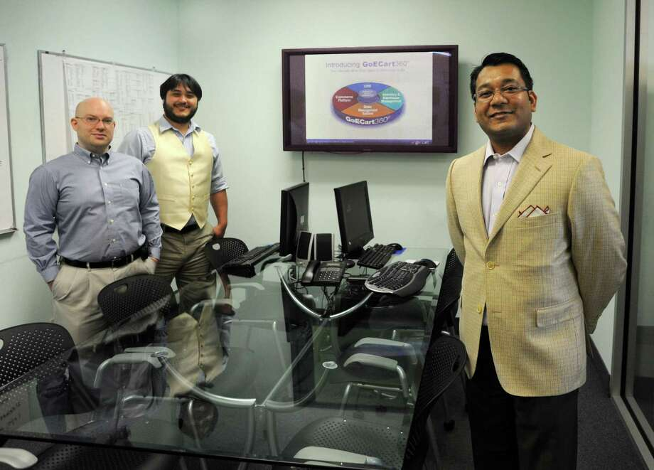 James McDougal, Director of Operations and Christoph Yasutake, Technical Support Specialist and Manish Chowdhary, CEO of GoECart in their office at 10 Middle Street in Bridgeport, Conn. on Thursday  May 31, 2012. The company is officially launching their new product, GoECart 360, a one-stop shop for retailers hoping to develop an E-commerce site. Photo: Cathy Zuraw / Connecticut Post
