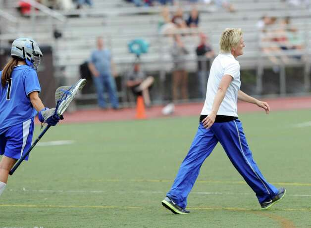 Darien High School girls lacrosse coach Lisa Lindley, right, walks away after grabbing her goalie Caylee Waters during a timeout in the first half of the FCIAC girls lacrosse finals between Greenwich High School and Darien High School at Brien McMahon High School in Norwalk, Friday, May 25, 2012. Darien won the championship over Greenwich 17-14. Photo: Bob Luckey / Greenwich Time