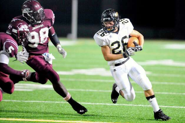 Vidor running back David Smallwood rushes against Central defenders Kyle Holmes (98) and Nicalus Rhone (5) in the first half at the BISD Thomas Center on Friday.   Friday, October 21, 2011.  Valentino Mauricio/The Enterprise Photo: Valentino Mauricio