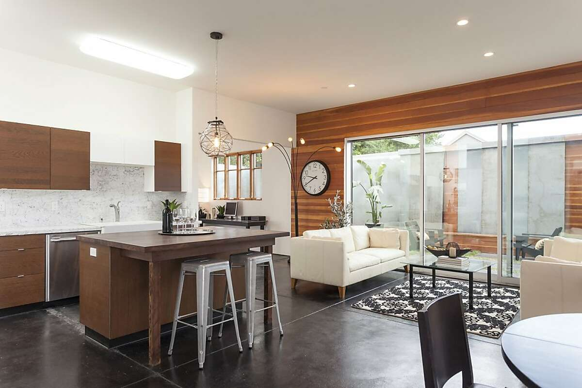 The living and dining room provide an open space alongside the modern kitchen, which listing agent Daniel Winkler says makes the home ideal for entertaining.