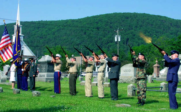 The firing squad offers a gun salute as a climax to the Memorial Day ceremony in Kent. May 28, 2012 Photo: Trish Haldin