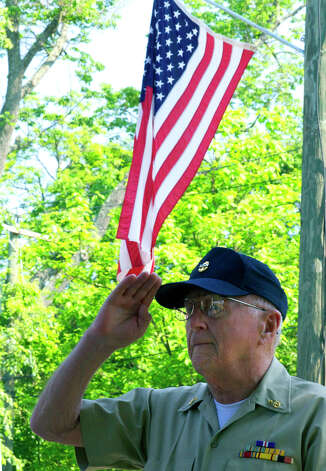 Hilmer Parson, a U.S. Navy chief, retired, holds his salute during the Memorial Day parade in Kent, May 28, 2012 Photo: Trish Haldin