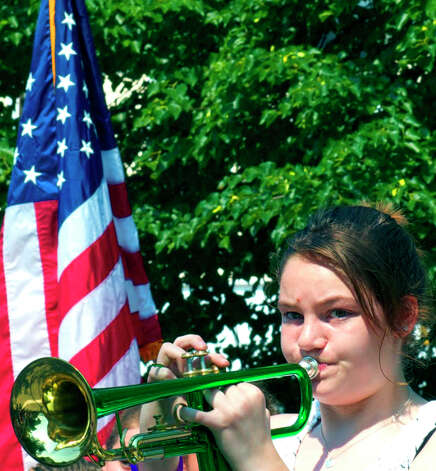 "Seventh-grader Lily Bournival, 13, plays ""Taps"" at the conclusion of the Memorial Day ceremony in Kent, May 28, 2012 Photo: Trish Haldin"