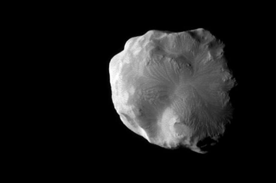 HELENE: This icy moon of Saturn Helene is officially named for Helen of Troy, who was the granddaughter of Cronus (Saturn) in Greek mythology.   (Cassini Imaging Team)