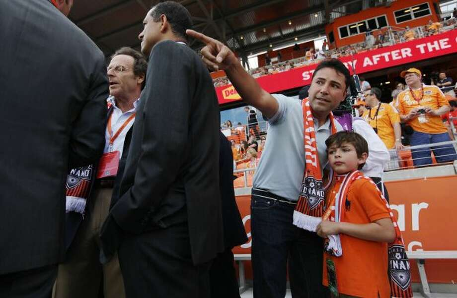 OSCAR: Part owner of the Houston Dynamo, retired boxer Oscar De La Hoya, with son Oscar De La Hoya, Jr., at BBVA Compass Stadium on Saturday, May 12, 2012, in Houston.  (Mayra Beltran / Houston Chronicle)