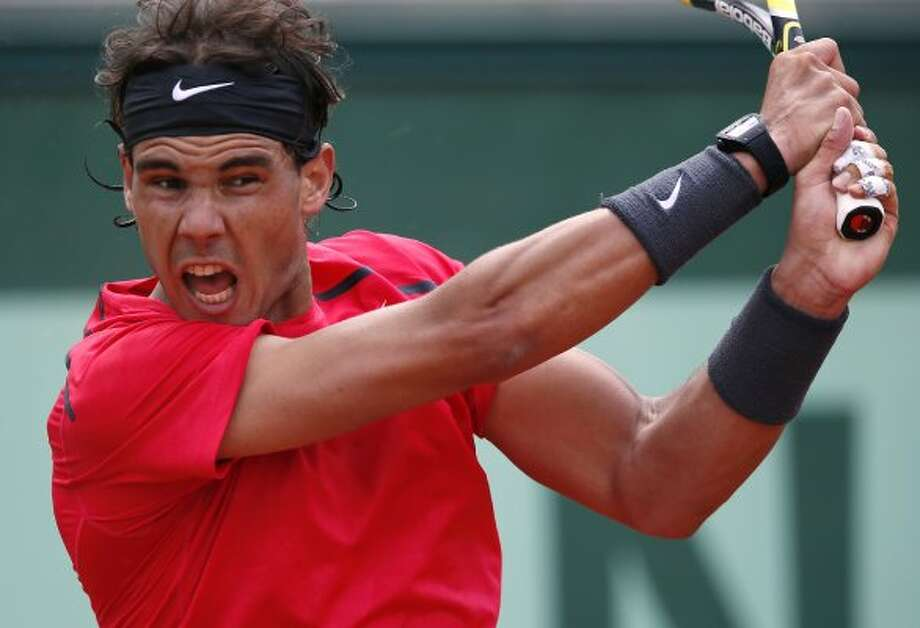 RAFAEL: Spain's Rafael Nadal hits a return to Uzbekistan's Denis Istomin during their men's Singles 2nd Round tennis match of the French Open tennis tournament at the Roland Garros stadium, on May 31, 2012 in Paris.  (THOMAS COEX / AFP/Getty Images)