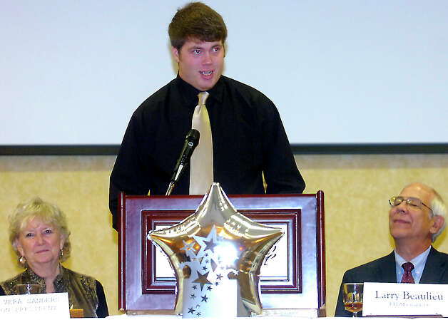 Nederland's Corbin Carr accepts the Willy Ray Smith Award during the award banquet at the MCM Elegante' in Beaumont, Wednesday, February 15, 2012. Tammy McKinley/The Enterprise Photo: TAMMY MCKINLEY