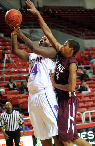 West Brook's Jared Castle shoots for two as Silsbee's Kendrick Jones guards at the Montagne Center in Beaumont, Friday. Tammy McKinley/ The Enterprise Photo: TAMMY MCKINLEY / Beaumont