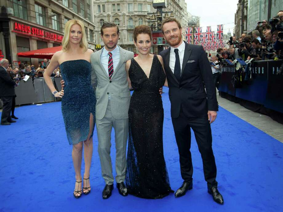 From left, actors Charlize Theron, Logan Marshall-Green, Noomi Rapace and Michael Fassbender arrive at a central London cinema for the World Premiere of Prometheus, Thursday, May 31, 2012. (AP Photo/Joel Ryan) Photo: Joel Ryan, Associated Press / AP