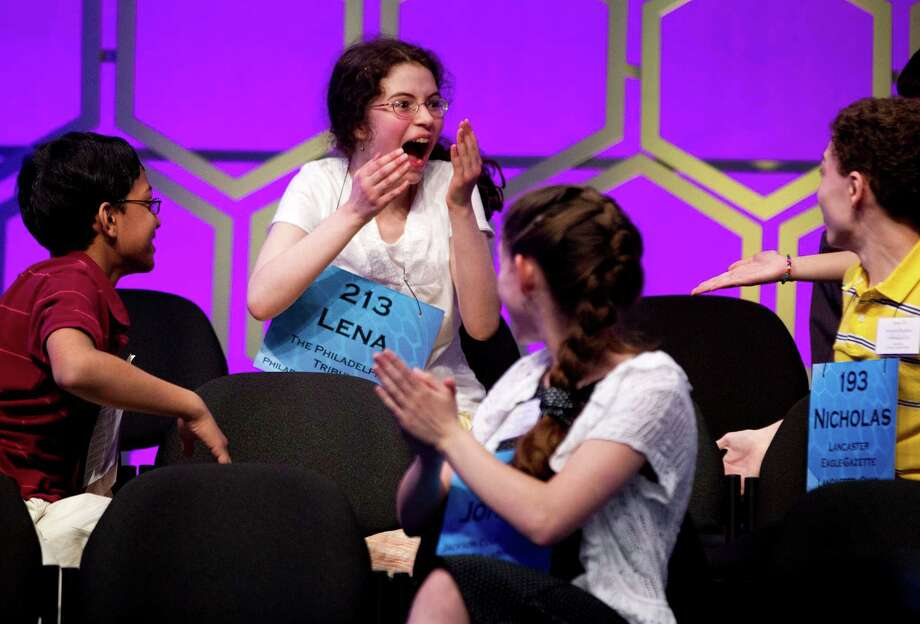 "Lena Greenberg, 14, of Philadelphia, celebrates with other contestants after spelling the word ""cholecystitis"" correctly during the semifinal round of the National Spelling Bee, Thursday, May 31, 2012, in Oxon Hill, Md.  (AP Photo/Evan Vucci) Photo: Evan Vucci, Associated Press / AP"